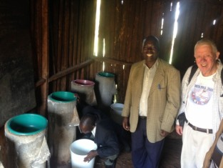 Jim Collinson inspects some bio-sand filters with friends at a Kenya primary school.